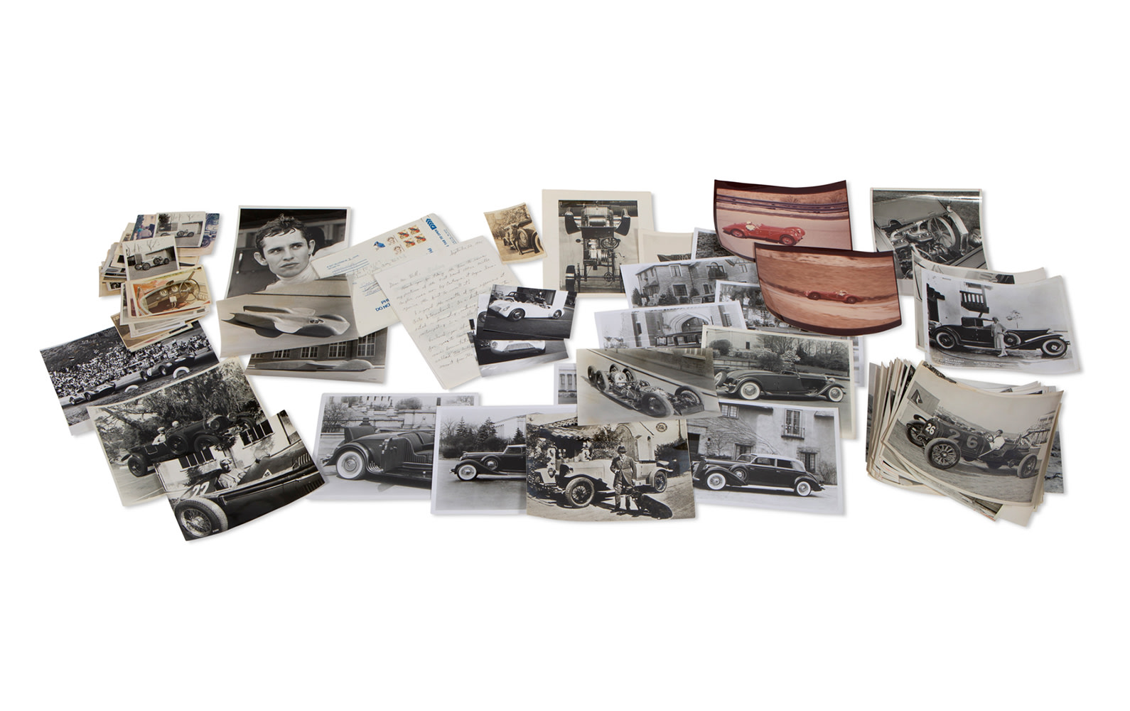 Assorted Color and Black and White Photographs Featuring Ferrari, Alfa Romeo, Rolls Royce and More