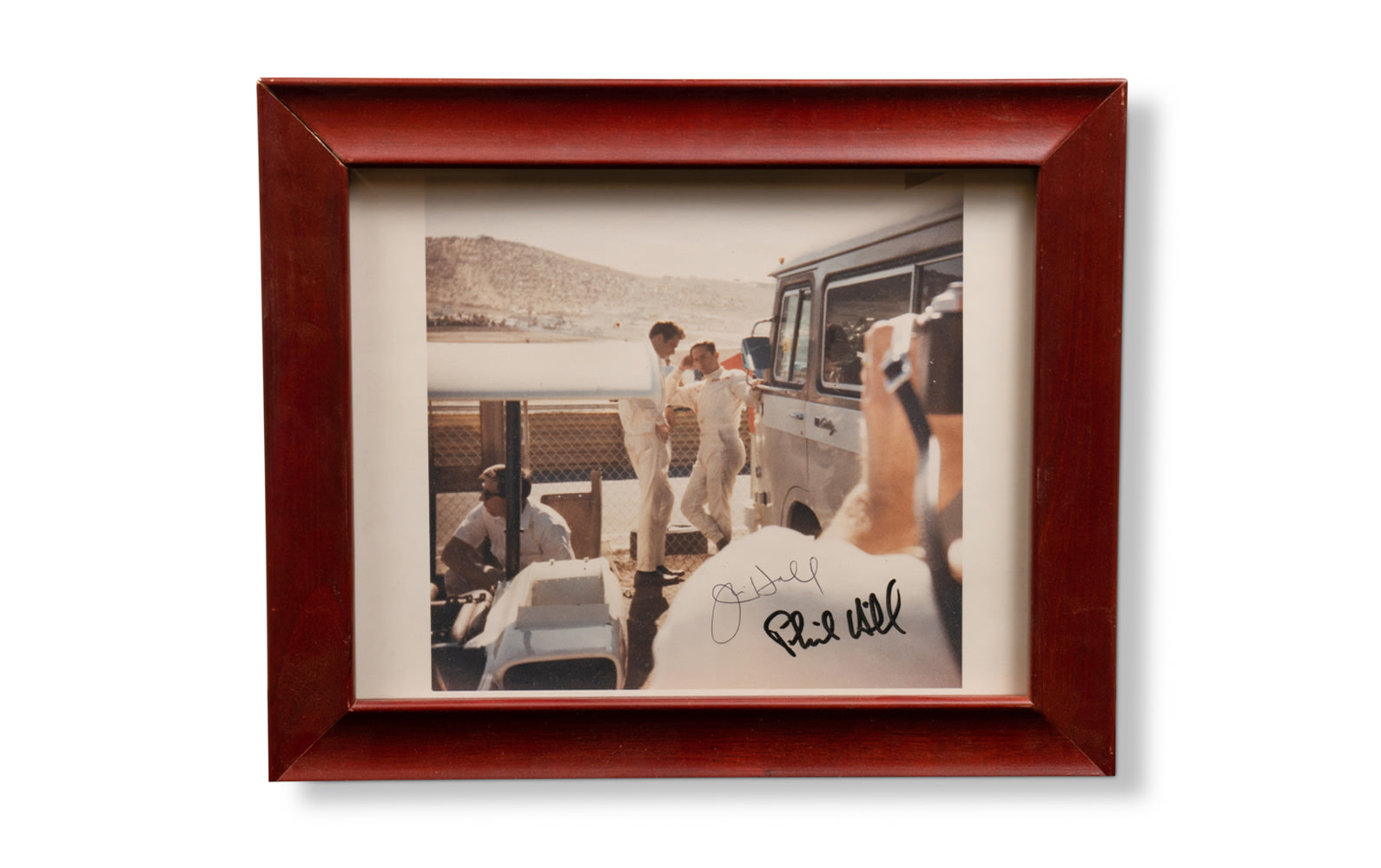 Signed Photograph of Phil Hill and Jim Hall at Laguna Seca, 1966