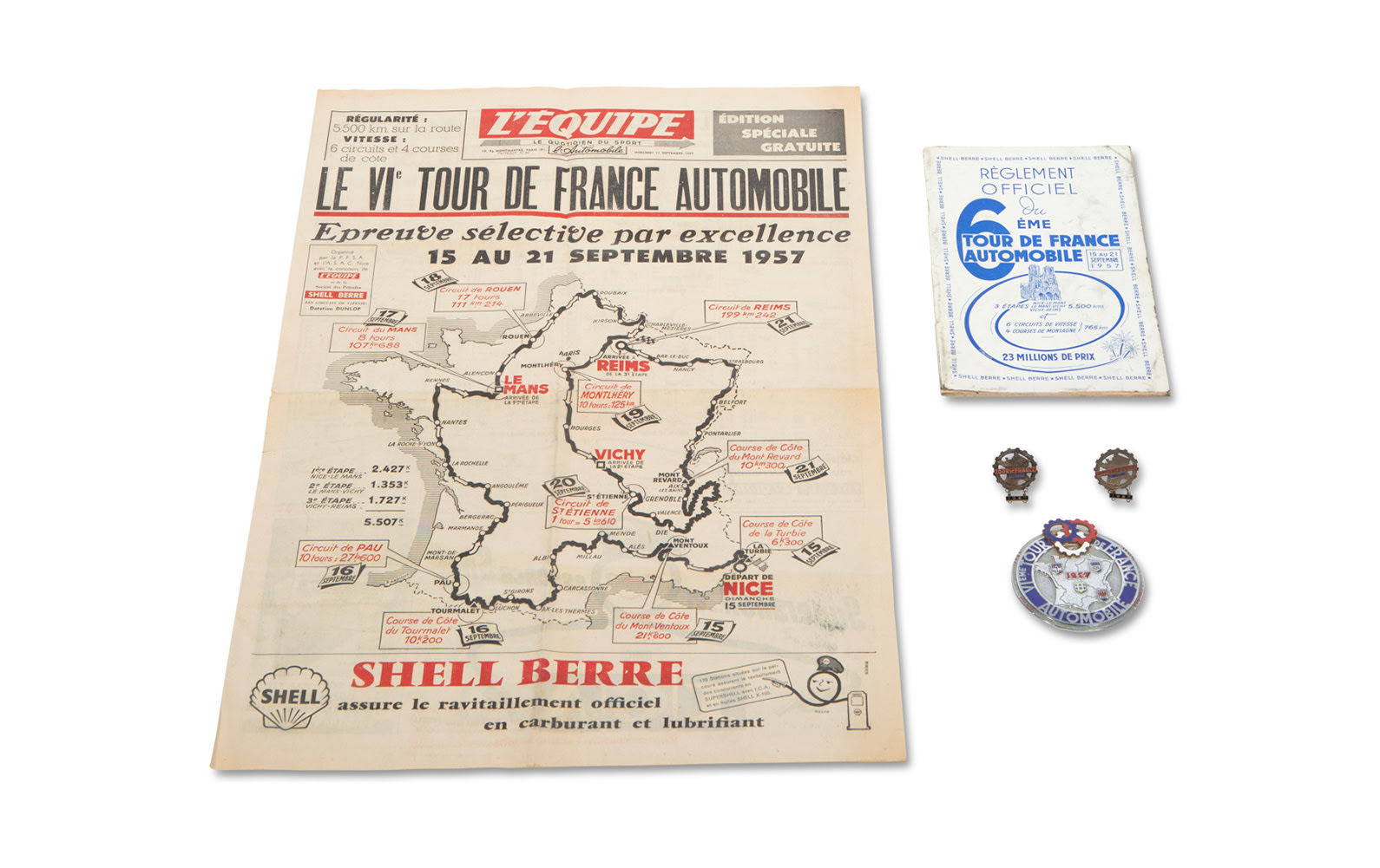 1957 Tour de France Automobile Official Rulebook, Cover of L'Equipe Newspaper, Event Badge, and Two Event Medallions