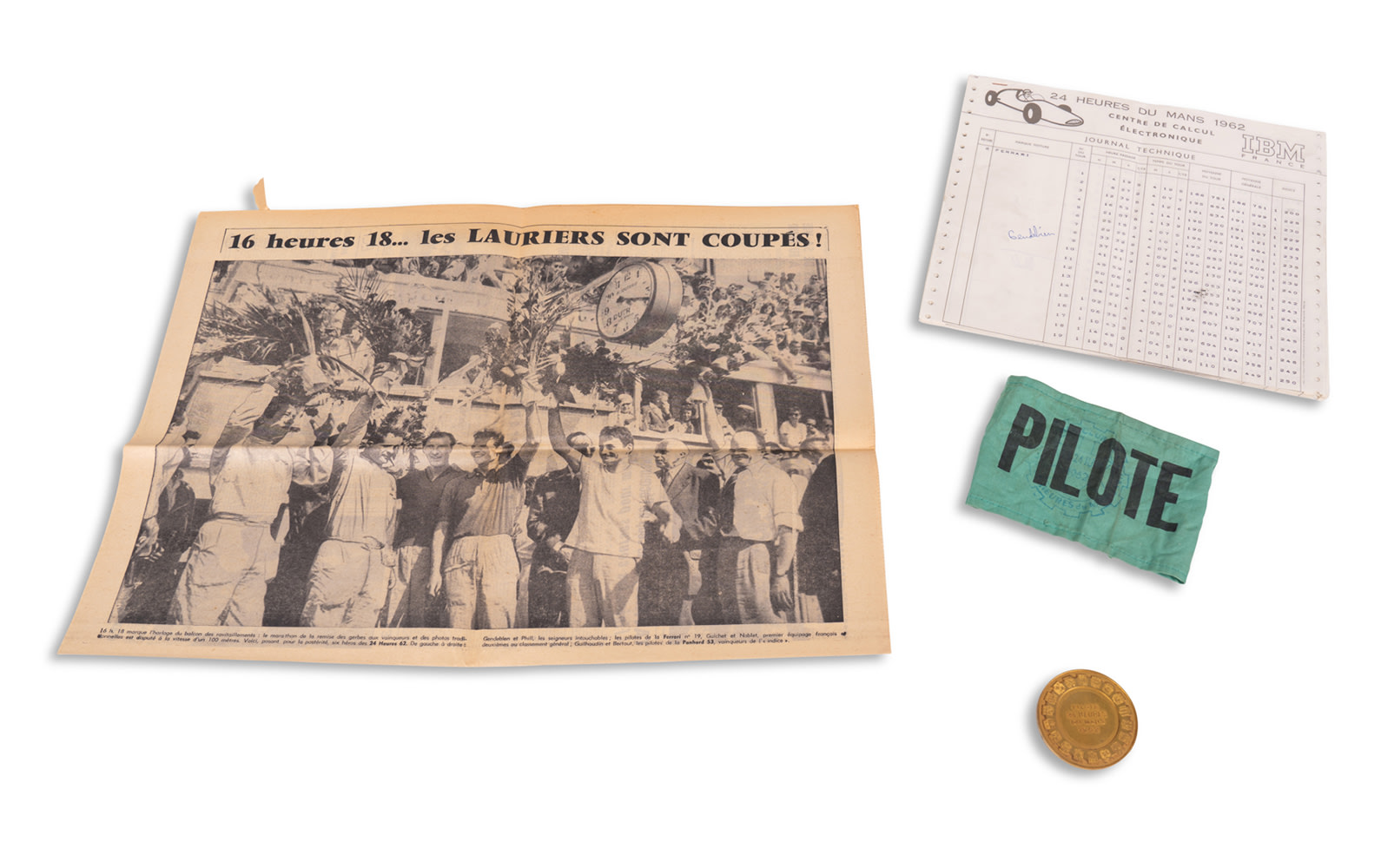 1962 24 Hours of Le Mans Driver Armband, Timesheets, Local Newspaper, and Pilote Coin