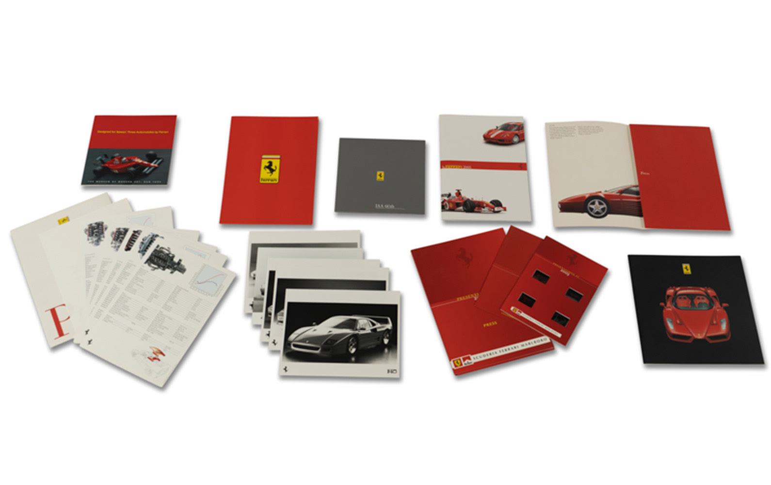 Assorted Ferrari Press and Promotional Materials, Including 2003 Press Kit with F2003-GA Photo Slides