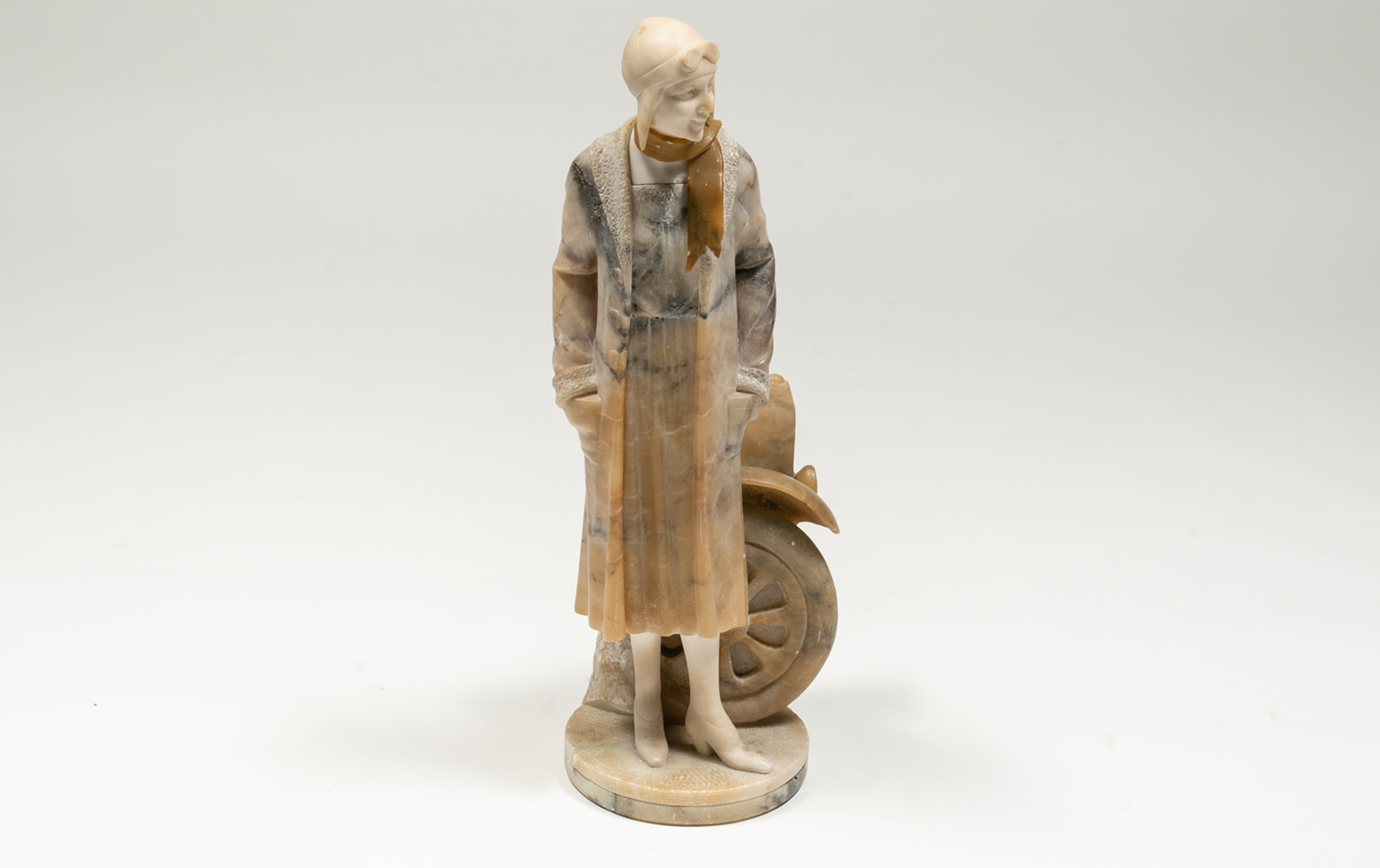 c.Late 1920s–Early 1930s Marble Sculpture of a Female Motorist