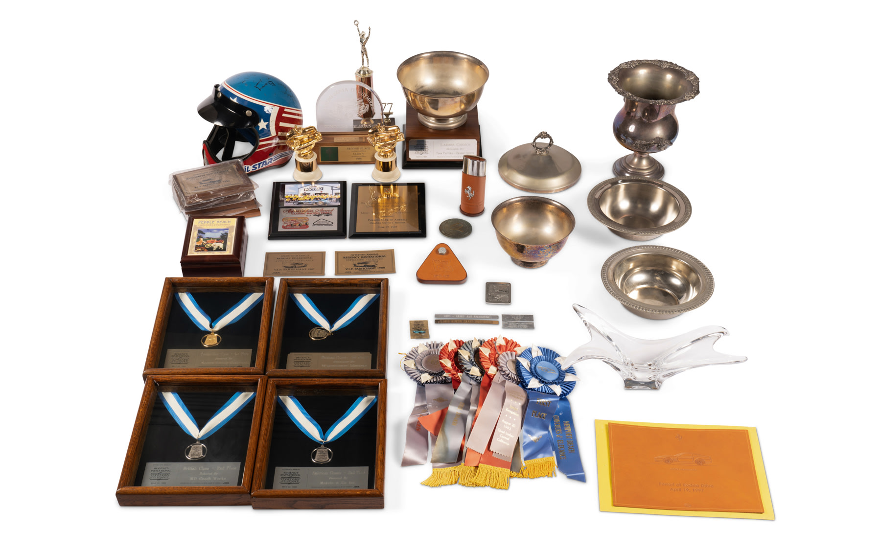 Assorted Awards and Trophies Including Helmet Signed by Phil Hill, Stirling Moss, and Others